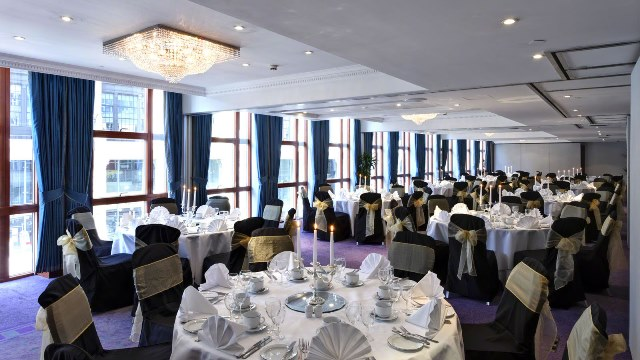 Orion Suite with round tables dressed for dinner with natural daylight Grange Holborn Hotel Venue Hire WC1
