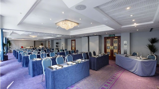 Orion Suite set up in classroom style for a conference with natural daylight Grange Holborn Hotel Venue Hire WC1