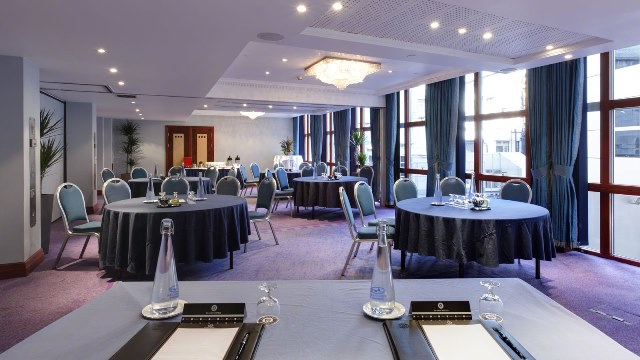Persus Suite with round tables in cabaret style with natural daylight set up for a conference Grange Holborn Hotel Venue Hire WC1