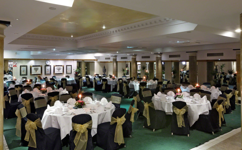 Swimming Pool hydraulic floor with round tables and chairs dressed for dinner Grange Holborn Hotel Venue Hire WC1