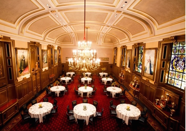 Livery Hall with round tables dressed in white linen at Clothworkers Hall Christmas Party EC3