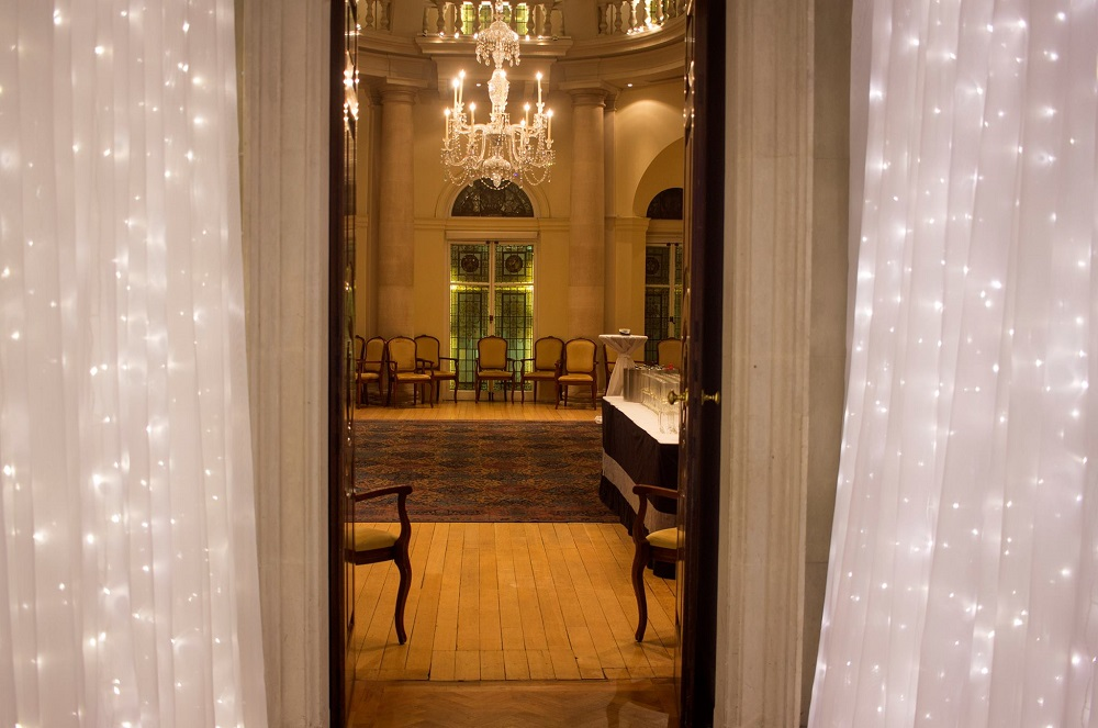 Long hall way with fairy lights covering both walls