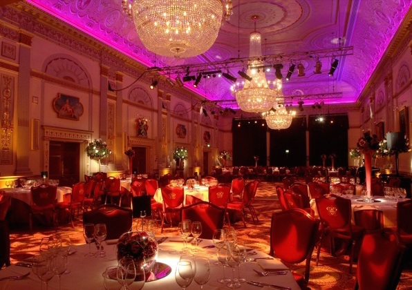 One London Wall Christmas Party EC2, festive centre pieces, large chandeliers, colour wash throughout the room to create a festive feel