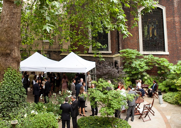 Stationers Hall Summer Party EC4. birds eye view of venues courtyard. with plants and greenery around. guests enjoiying their summer party