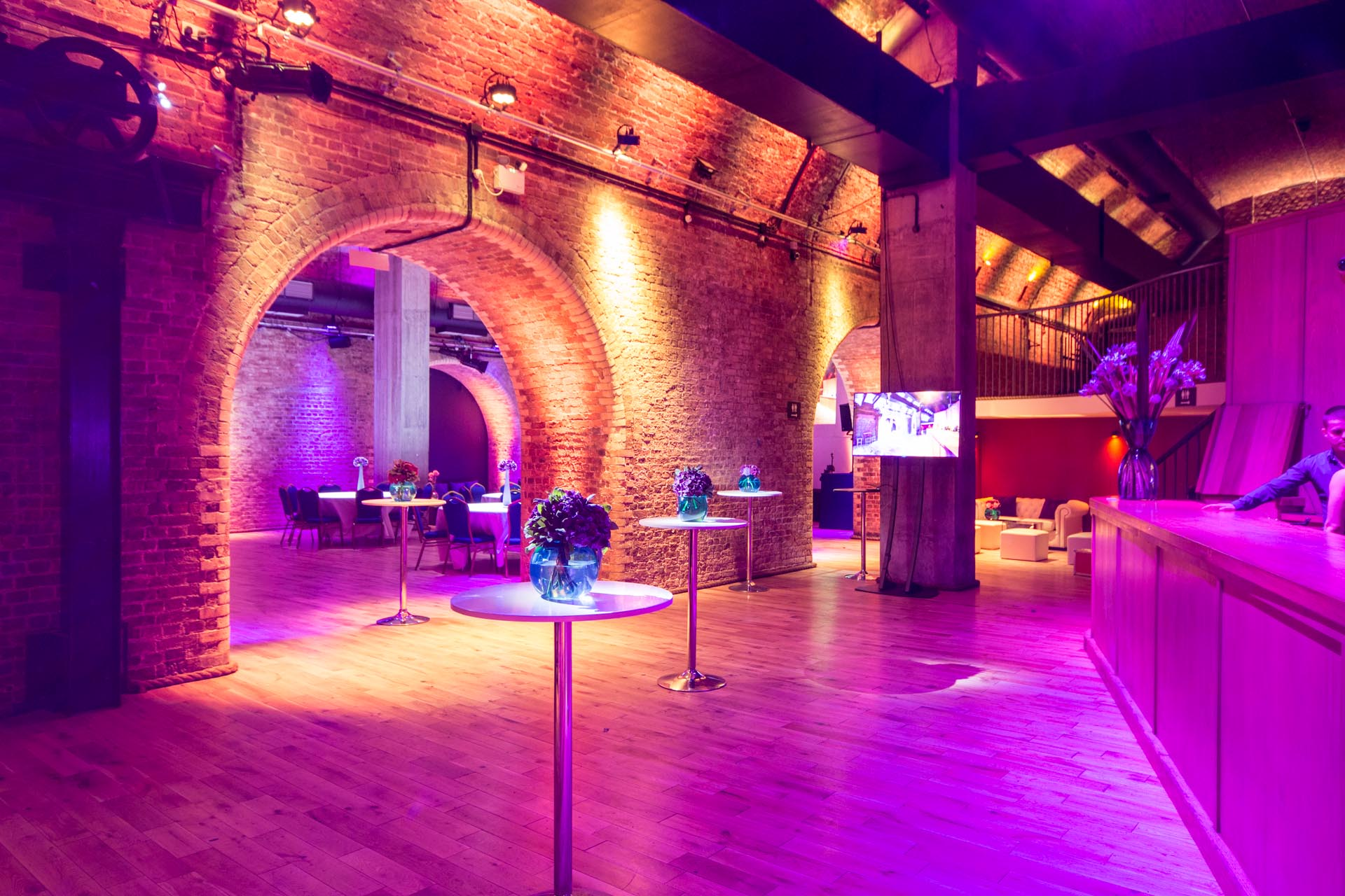 Steel Yard London Venue Hire EC3, archs lit up with purple uplighters
