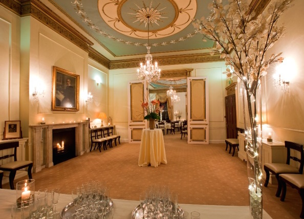 Harben Room set for a festive drinks reception with grand high ceiling and open fireplace 28 Portland Place Christmas Party W1