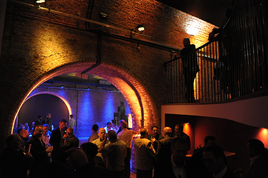 Steel Yard London Venue Hire EC3, guests mingling under the arches