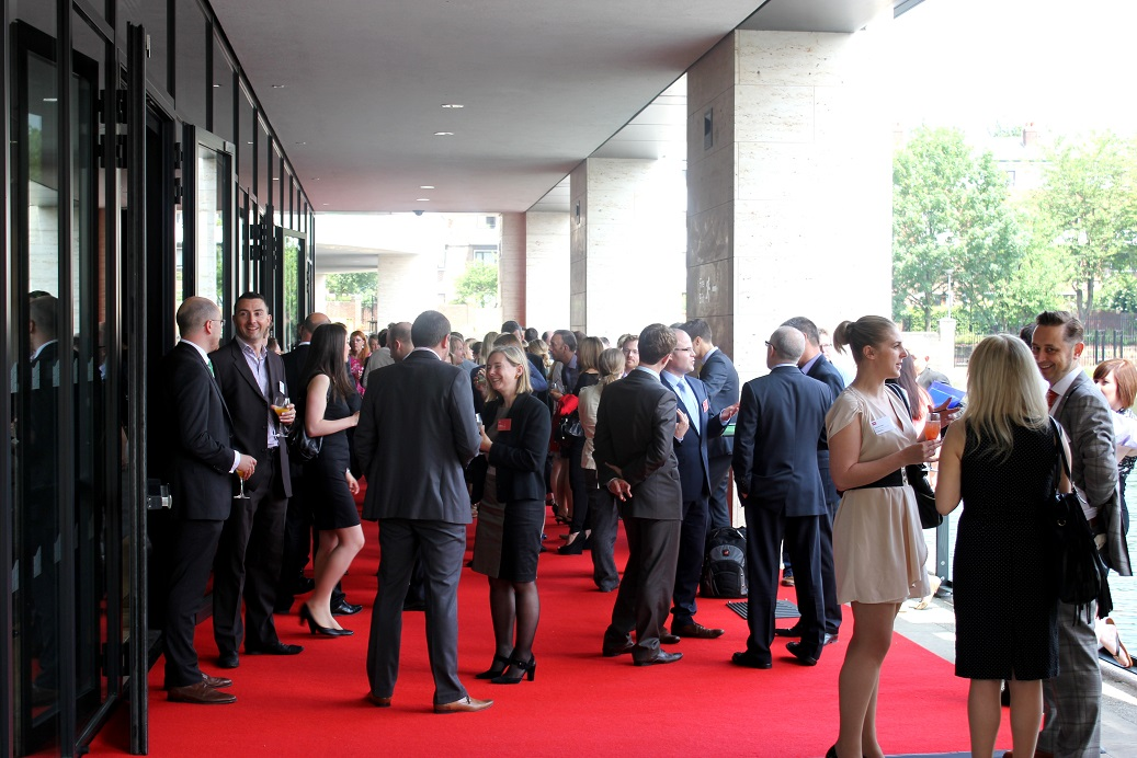 Kings Place Summer Party N1- Evening guests having a summer drinks reception on the battlebridge terrace