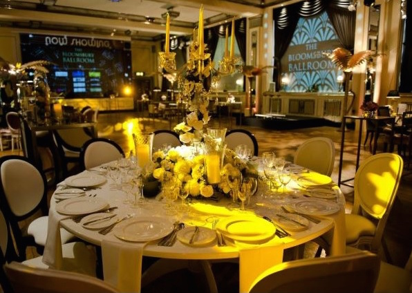 Bloomsbury Ballroom Christmas Party WC1, round tables set for dinner with stunning centre pieces