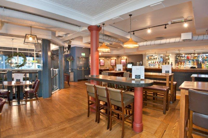 Bonds Mayfair Venue Hire W1 inside of pub with stalls and tables got guests