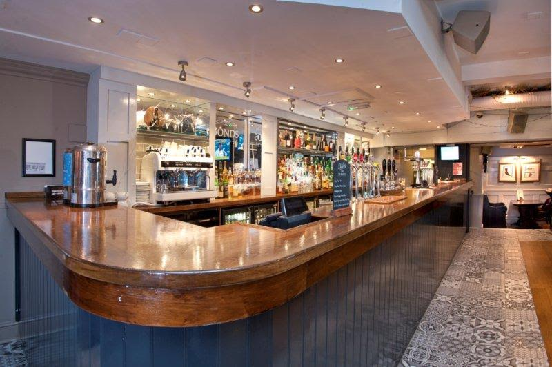 Bonds Mayfair Venue Hire W1 long large bar with tables and chairs