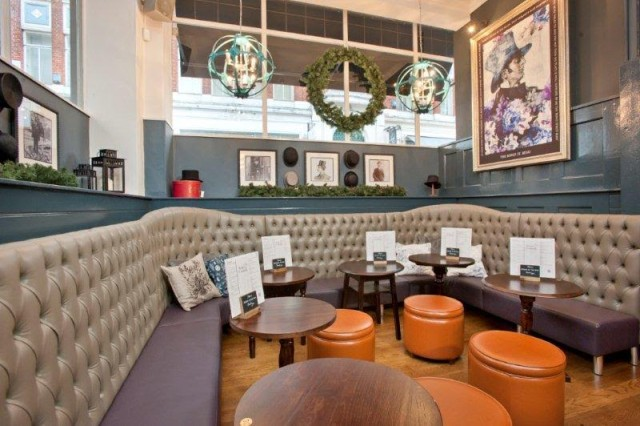 Private Room with informal sofa booth seat and bar stools with natural daylight Bonds Venue Hire W1