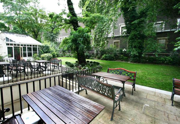 View of the Garden with summer benches Grange White Hall Summer Party Venue WC1