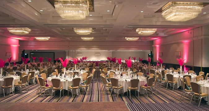 Hilton London Metropole Venue Hire W2, dining with pink centre pieces