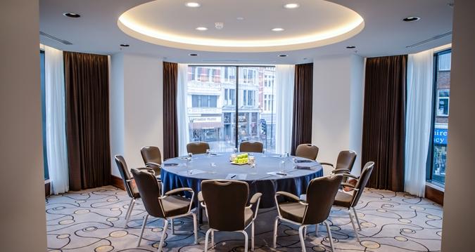 Hilton London Metropole Venue Hire W2, circular table in meeting room