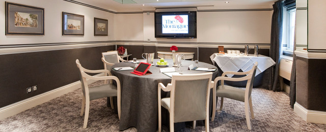 Bedford Suite with round table screen and tablet for a meeting at the Montague On The Gardens Hotel Venue Hire WC1