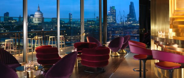 Mondrian Hotel Summer Party SE1 top floor with windows looking out to the CIty
