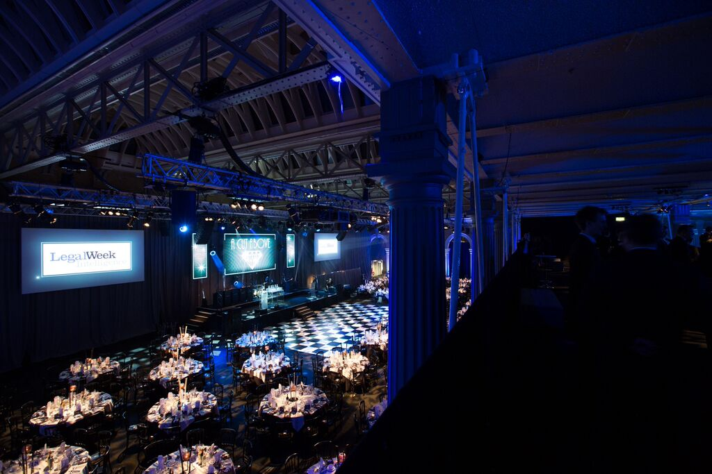Old Billingsgate Christmas Party EC1, large event space set for dinner, round tables