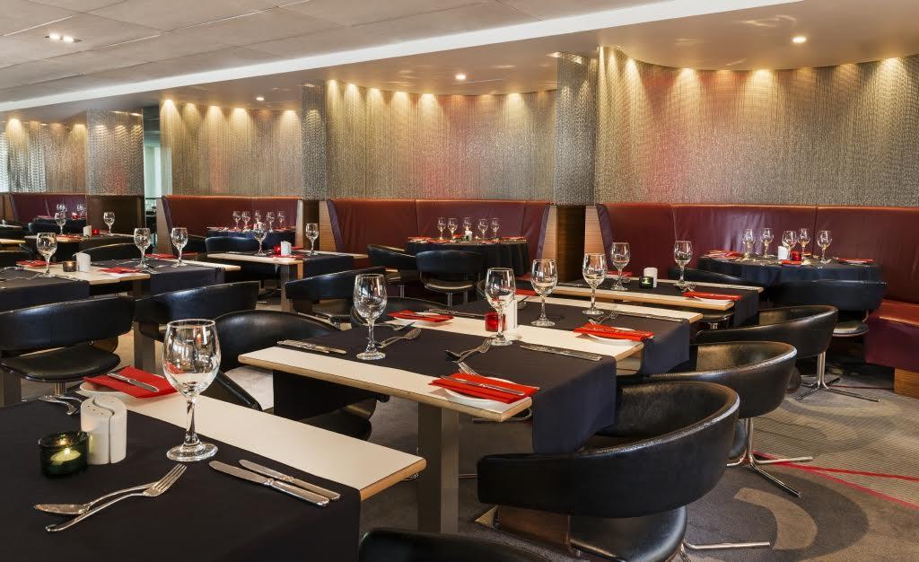 Park Inn Heathrow Shared Christmas Party UB7, restaurant set for seated dinner