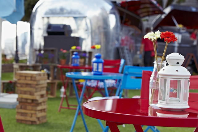 Lawn view of the garden games with bright coloured tables Tower Hotel Summer Party Venue E1