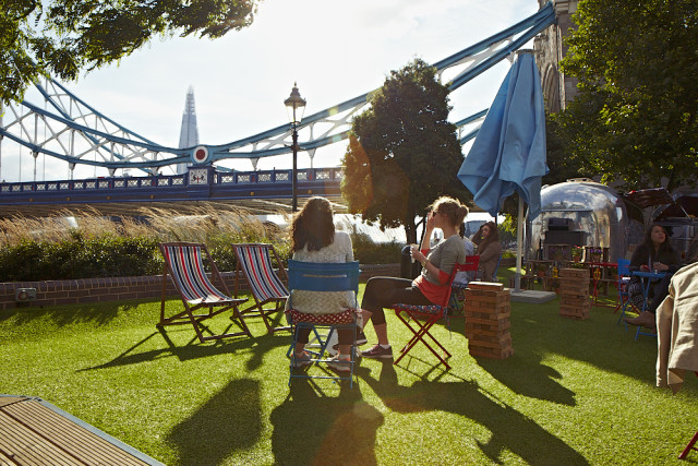 View of the Lawn with deck chairs and view of the Tower Bridge from the Tower Hotel Summer Party Venue E1