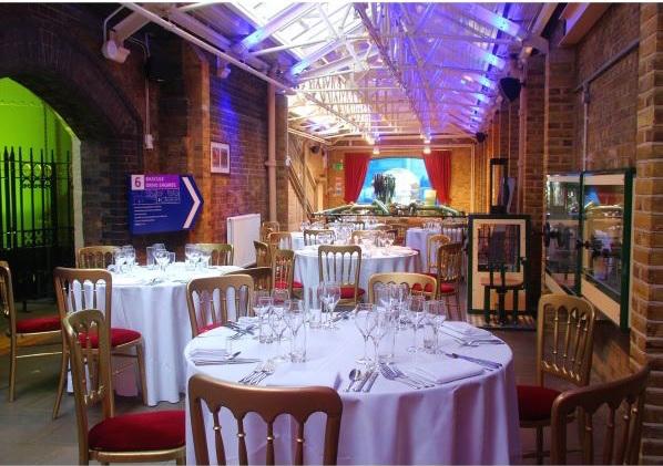 Tower Bridge Engine Rooms Christmas venue SE1, seated dinner area, theming, lighting