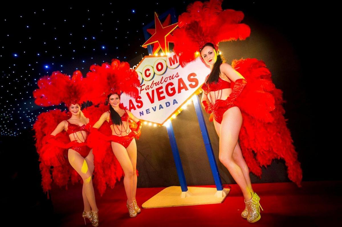 Vegas Shared Christmas Parties SE1- Vegas performers posing by viva las vegas sign