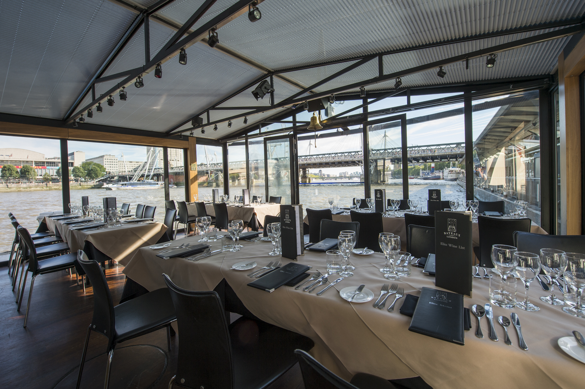 Bateaux Summer Party River Cruises WC2 inside of boat with tables and chairs