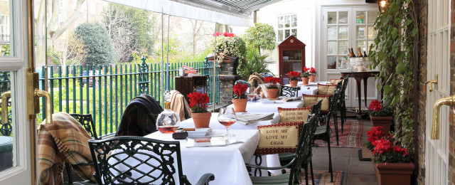 Cigar Terrace set up for an afternoon tea with white linen and pillows on the chairs Montague On The Gardens Hotel Venue Hire WC1