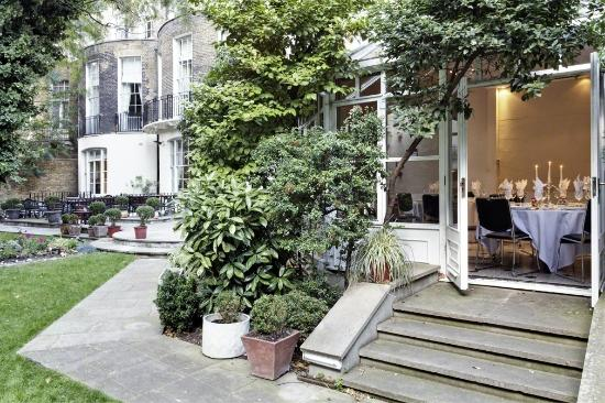 View of the steps from the Garden Patio leading into the conservatory Grange White Hall Summer Party Venue WC1