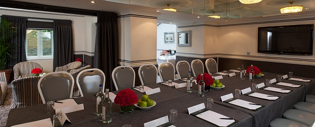 Woburn Suite set out in boardroom style with natural daylight in Montague Gardens Hotel Venue Hire WC1