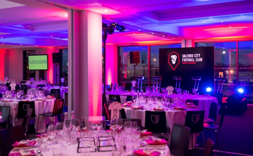 Round tables set for dinner in the Stadium Suite Hotel Football Old Trafford Venue Hire M16