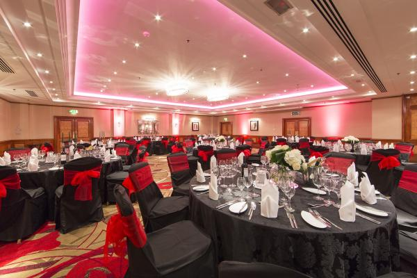 Dinner layout with tables dressed in black for a party in the Hyde Park Suite Amba Marble Arch Venue Hire W1