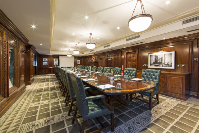 Permanent boardroom layout with leather green chairs in the Speakers Corner Amba Marble Arch Venue Hire W1