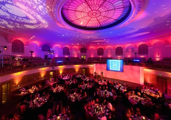 Church House Christmas Party Venue SW1, Large circular room set for a banquet on round tables
