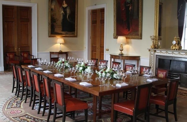 Court Room set for a private dinnerwith large oak table with grand paintings on the wall Trinity House Christmas Party EC3