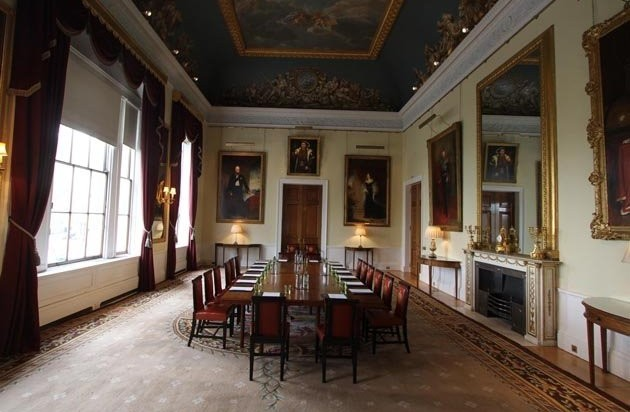 Court Room set for a boardroom in boardroom style with large windows and grand paintings on the wall Trinity House Venue Hire EC3