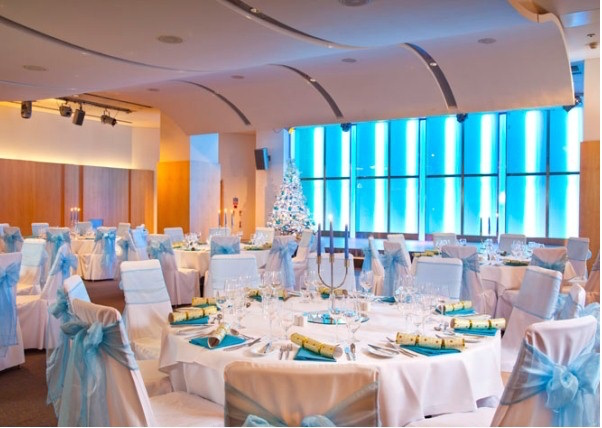 Cumberland Hotel Christmas Party W1, large round tables, festive decorations, colour wash