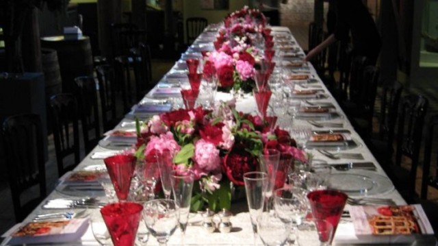 Galleries set for a private dinner with in banqueting style with white table linen and floral centre pieces Museum of Docklands Christmas Party E14