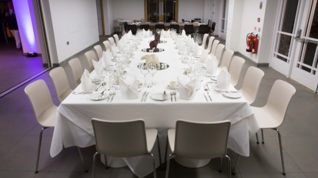 Garden Room set for a private dinner in boardroom style with white table linen ZSL London Zoo Venue Hire NW1