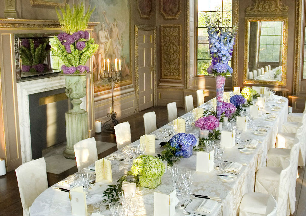 Hampton Court Palace Venue Hire KT8, dinner set up, stunning flower centre pieces, natural daylight, fireplace