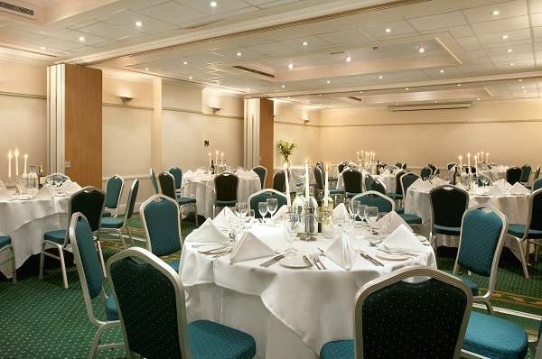 Hilton London Euston Christmas Party WC1, christmas party set up on round tables