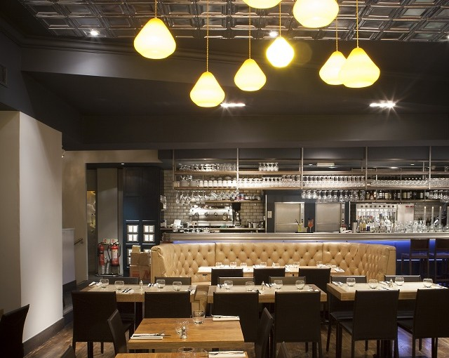 Hush Holborn Venue Hire WC1. Main room, restaurant has a warm feel to it with industral lighting