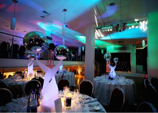 Holiday Inn Camden Lock Christmas NW1. Venue with festive lighting and table and cahirs decorated for celebrating.