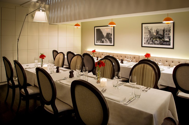 Hush Holborn Venue Hire WC1. Holborns private dining room with long tables and flower centre pieces