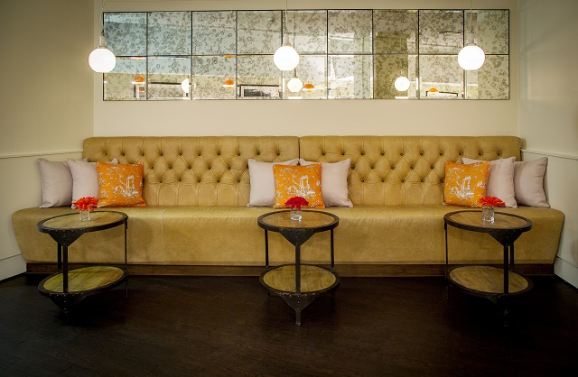 Hush Holborn Venue Hire WC1. private room with sofa and tables for guests to put their drinks and nibbles