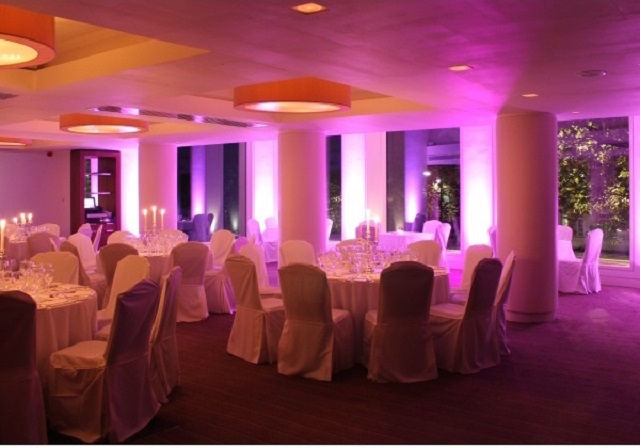 Lancaster London Christmas Party Venue W2. Set out for christmas part. round tables and festive lighting.