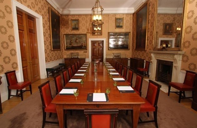Luncheon set for a conference in boardroom style with grand paintings hanging on the wall Room Trinity House Venue Hire EC3