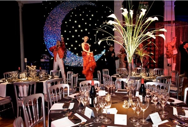Madame Tussauds Shared Christmas Party NW1, stunning dinner set up with table centre pieces, round tables, entertainment