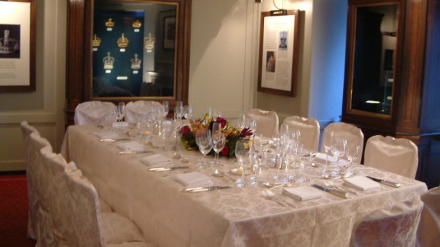 Martin Tower set for a private dinner with elegant glassware and floral centre piece with natural daylight and display cabinetTower of London Venue Hire EC3